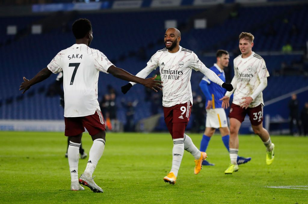 BRIGHTON, ENGLAND - DECEMBER 29: Alexandre Lacazette of Arsenal celebrates with teammates Mohamed Elneny, Bukayo Saka, Emile Smith Rowe and Pierre-Emerick Aubameyang after scoring his team's first goal during the Premier League match between Brighton & Hove Albion and Arsenal at American Express Community Stadium on December 29, 2020 in Brighton, England. The match will be played without fans, behind closed doors as a Covid-19 precaution. (Photo by Mike Hewitt/Getty Images)