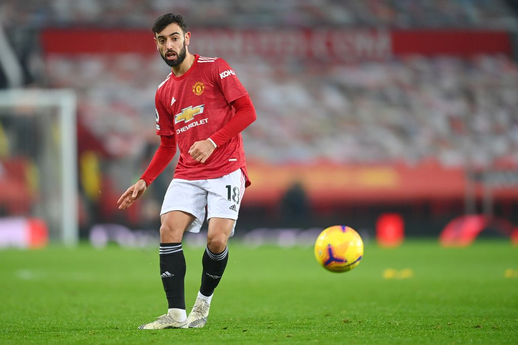 MANCHESTER, ENGLAND - DECEMBER 29: Bruno Fernandes of Manchester United in action during the Premier League match between Manchester United and Wolverhampton Wanderers at Old Trafford on December 29, 2020 in Manchester, England. The match will be played without fans, behind closed doors as a Covid-19 precaution. (Photo by Michael Regan/Getty Images)