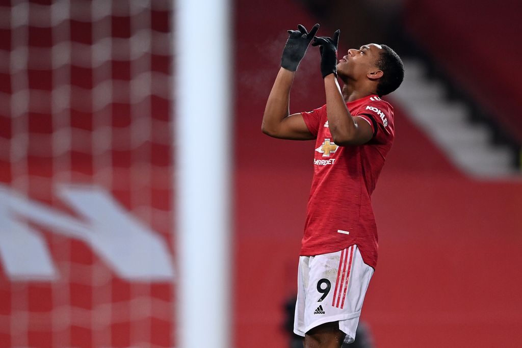 MANCHESTER, ENGLAND - JANUARY 01: Anthony Martial of Manchester United celebrates after scoring their team's first goal during the Premier League match between Manchester United and Aston Villa at Old Trafford on January 01, 2021 in Manchester, England. The match will be played without fans, behind closed doors as a Covid-19 precaution. (Photo by Laurence Griffiths/Getty Images)