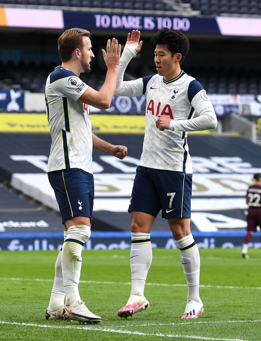 LONDON, ENGLAND - JANUARY 02: Harry Kane of Tottenham Hotspur celebrates with teammate Son Heung-Min of Tottenham Hotspur after scoring their team's first goal from the penalty spot during the Premier League match between Tottenham Hotspur and Leeds United at Tottenham Hotspur Stadium on January 02, 2021 in London, England. The match will be played without fans, behind closed doors as a Covid-19 precaution. (Photo by Andy Rain - Pool/Getty Images)