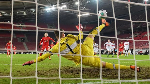 STUTTGART, GERMANY - JANUARY 02: Gregor Kobel of VfB Stuttgart saves a penalty from Emil Forsberg of RB Leipzig during the Bundesliga match between VfB Stuttgart and RB Leipzig at Mercedes-Benz Arena on January 02, 2021 in Stuttgart, Germany. Sporting stadiums around Germany remain under strict restrictions due to the Coronavirus Pandemic as Government social distancing laws prohibit fans inside venues resulting in games being played behind closed doors. (Photo by Matthias Hangst/Getty Images)