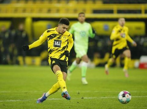 Dortmund's English midfielder Jadon Sancho scores the 2-0 during the German first division Bundesliga football match Borussia Dortmund v VfL Wolfsburg on January 3, 2021 in Dortmund, western Germany. (Photo by Leon KUEGELER / POOL / AFP) / DFL REGULATIONS PROHIBIT ANY USE OF PHOTOGRAPHS AS IMAGE SEQUENCES AND/OR QUASI-VIDEO
