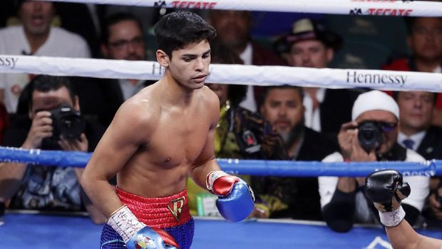 FILE - In this Nov. 2, 2019 file photo, Ryan Garcia, looks on after landing a punch to Romero Duno (not seen) during their lightweight boxing match in Las Vegas.   Garcia meets Britain's Luke Campbell, a 2012 Olympic champion, in an interim WBC lightweight title fight. The bout was postponed a month and moved from California after Campbell tested positive for COVID-19.(AP Photo/Isaac Brekken, File)