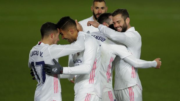Real Madrid's Marco Asensio, second right, celebrates with teammates Nacho, right, Casemiro, second left, and Lucas Vazquez, left, after scoring his side's second goal during the Spanish La Liga soccer match between Real Madrid and Celta Vigo at the Alfredo Di Stefano stadium in Madrid, Spain, Saturday, Jan. 2, 2021. (AP Photo/Manu Fernandez)