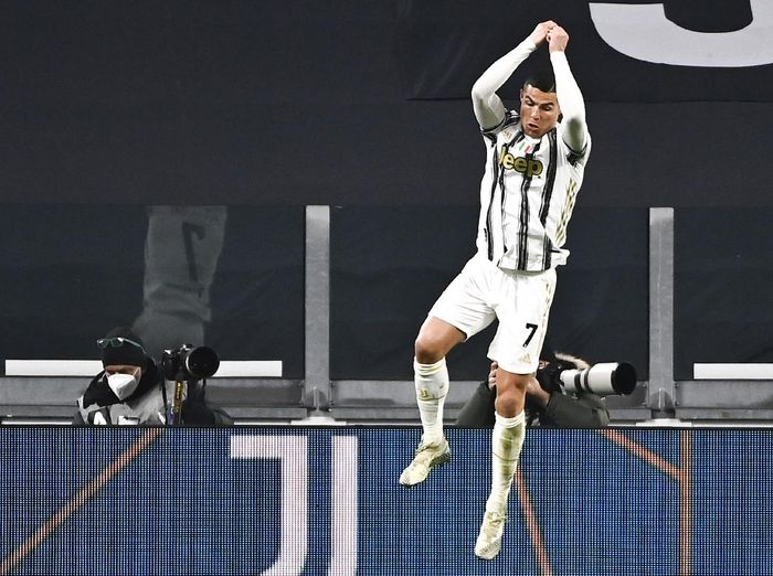 Cristiano Ronaldo of Juventus celebrates after scoring 3-0 during the Italian Serie A soccer match between Juventus and Udinese at the Allianz Stadium in Turin, Italy, Sunday Jan. 3, 2021. (Marco Alpozzi/LaPresse via AP)