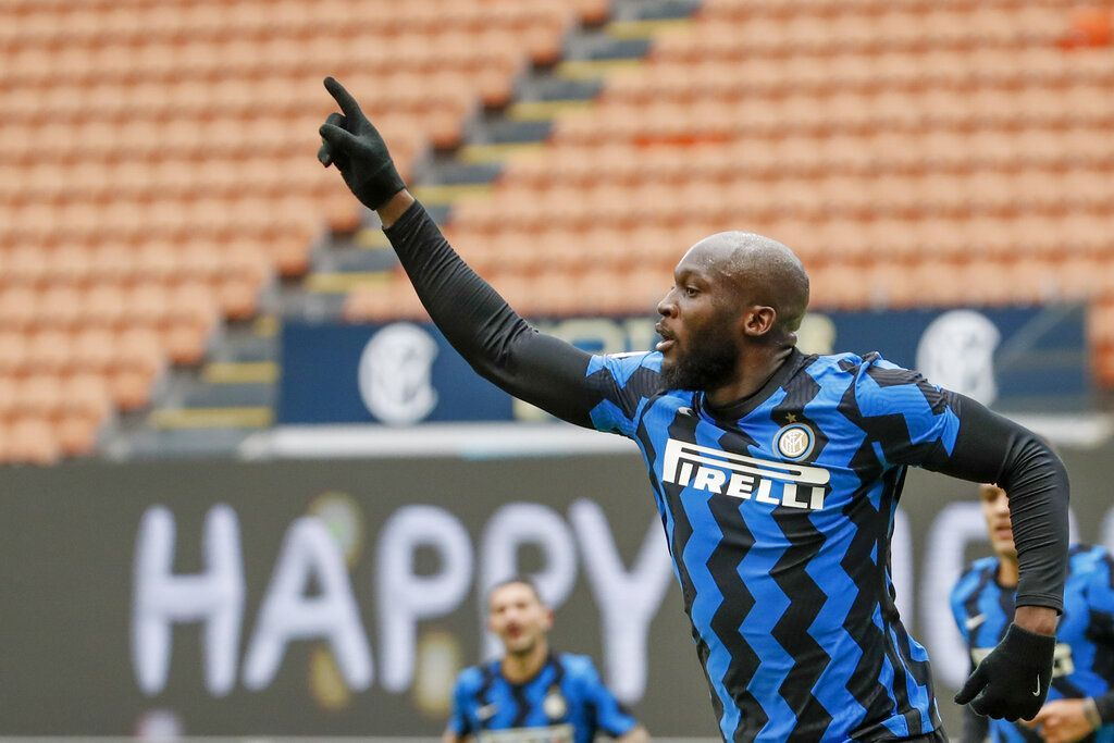 Inter Milan's Romelu Lukaku celebrates after he scored his side's fourth goal during the Serie A soccer match between Inter Milan and Crotone at the San Siro Stadium in Milan, Italy, Sunday, Jan. 3, 2021. (AP Photo/Antonio Calanni)