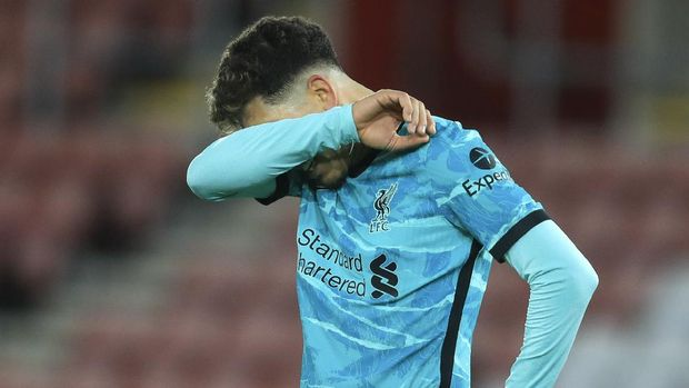 Liverpool's Roberto Firmino reacts following the English Premier League soccer match between Southampton and Liverpool at St Mary's Stadium, Southampton, England, Monday, Jan. 4, 2021. (AP Photo/Adam Davy,Pool)