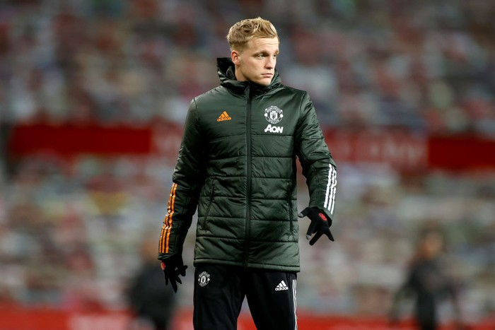 MANCHESTER, ENGLAND - DECEMBER 12: Donny Van De Beek of Manchester United looks on during the warm up prior to the Premier League match between Manchester United and Manchester City at Old Trafford on December 12, 2020 in Manchester, England. The match will be played without fans, behind closed doors as a Covid-19 precaution. (Photo by Phil Noble - Pool/Getty Images)