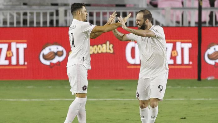 FORT LAUDERDALE, FLORIDA - OCTOBER 03: Julian Carranza #21 of Inter Miami CF celebrates with Gonzalo Higuain #9 after scoring a goal was disallowed after a review ruled it offside against New York City FC at Inter Miami CF Stadium on October 03, 2020 in Fort Lauderdale, Florida.   Michael Reaves/Getty Images/AFP