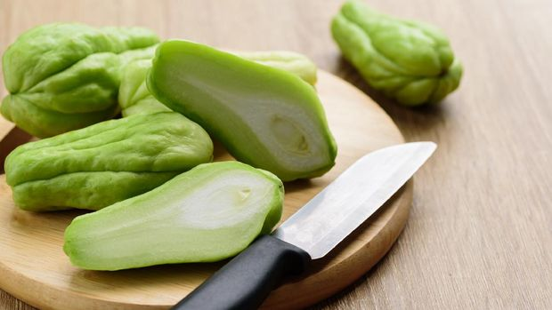 Chayote squash or Mirlition squash on cutting wooden board preparing for cooking