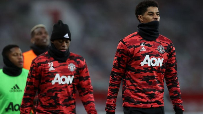 MANCHESTER, ENGLAND - JANUARY 01: Marcus Rashford of Manchester United warms up prior to the Premier League match between Manchester United and Aston Villa at Old Trafford on January 01, 2021 in Manchester, England. The match will be played without fans, behind closed doors as a Covid-19 precaution. (Photo by Carl Recine - Pool/Getty Images)