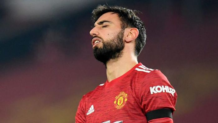 MANCHESTER, ENGLAND - JANUARY 06: Bruno Fernandes of Manchester United reacts during the Carabao Cup Semi Final match between Manchester United and Manchester City at Old Trafford on January 06, 2021 in Manchester, England. The match will be played without fans, behind closed doors as a Covid-19 precaution. (Photo by Peter Powell - Pool/Getty Images)
