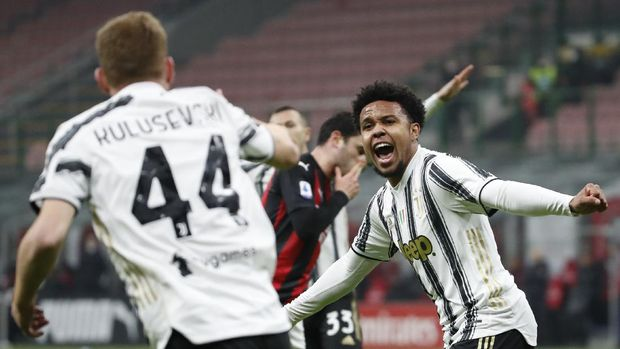 Juventus' Weston McKennie, right, celebrates with Juventus' Dejan Kulusevski after scoring his side's third goal during the Serie A soccer match between AC Milan and Juventus at the San Siro stadium, in Milan, Italy, Wednesday, Jan. 6, 2021. (AP Photo/Antonio Calanni)