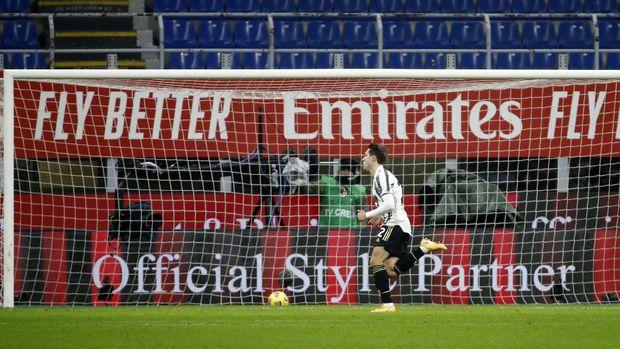 Juventus' Federico Chiesa celebrates after scoring his side's opening goal during the Serie A soccer match between AC Milan and Juventus at the San Siro stadium, in Milan, Italy, Wednesday, Jan. 6, 2021. (AP Photo/Antonio Calanni)
