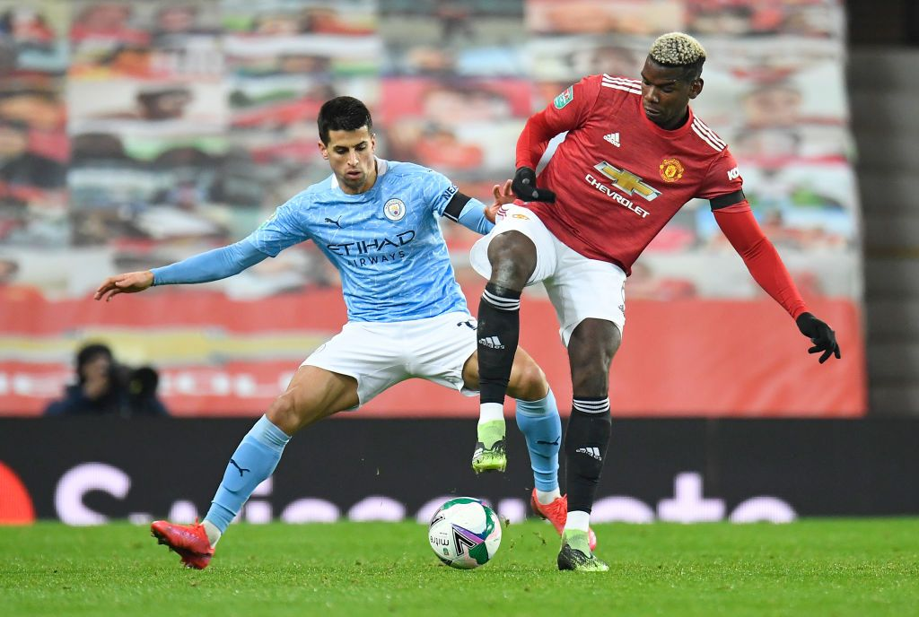 MANCHESTER, ENGLAND - NOVEMBER 08: Joao Cancelo of Manchester City on the ball during the Premier League match between Manchester City and Liverpool at Etihad Stadium on November 08, 2020 in Manchester, England. Sporting stadiums around the UK remain under strict restrictions due to the Coronavirus Pandemic as Government social distancing laws prohibit fans inside venues resulting in games being played behind closed doors. (Photo by Clive Brunskill/Getty Images)