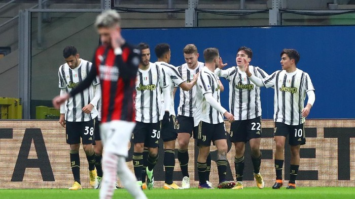 MILAN, ITALY - JANUARY 06: Federico Chiesa of Juventus F.C. celebrates after he scores his sides first goal during the Serie A match between AC Milan and Juventus at Stadio Giuseppe Meazza on January 06, 2021 in Milan, Italy. Sporting stadiums around Italy remain under strict restrictions due to the Coronavirus Pandemic as Government social distancing laws prohibit fans inside venues resulting in games being played behind closed doors. (Photo by Marco Luzzani/Getty Images)
