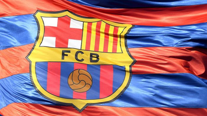 BARCELONA, SPAIN - APRIL 04:  The Barcelona logo is seen on a flag waving above the stadium prior to the UEFA Champions League Quarter Final Leg One match between FC Barcelona and AS Roma at Camp Nou on April 4, 2018 in Barcelona, Spain.  (Photo by Mike Hewitt/Getty Images)