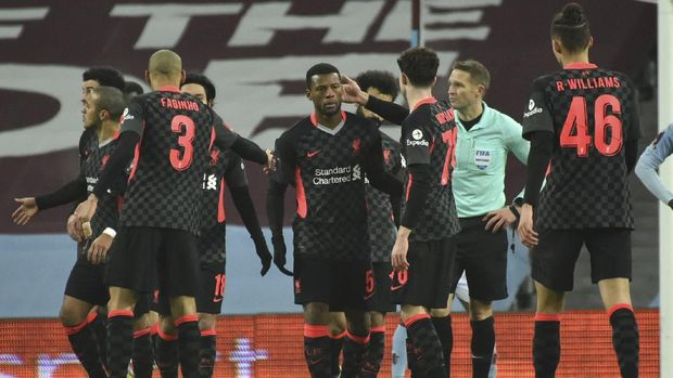 Liverpool's Georginio Wijnaldum, center, celebrates after scoring his side's second goal, during the FA Cup 3rd round soccer match between Aston Villa and Liverpool at Villa Park stadium in Birmingham, England, Friday, Jan. 8, 2021. (AP Photo/Rui Vieira)