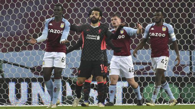 Liverpool's Mohamed Salah gestures after his goal was disallowed during the FA Cup 3rd round soccer match between Aston Villa and Liverpool at Villa Park stadium in Birmingham, England, Friday, Jan. 8, 2021. (AP Photo/Rui Vieira)