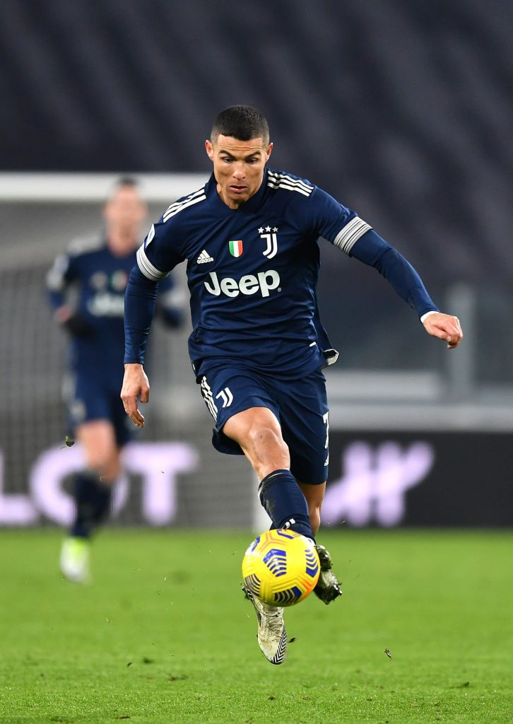 TURIN, ITALY - JANUARY 10: Cristiano Ronaldo of Juventus F.C. controls the ball during the Serie A match between Juventus and US Sassuolo at Allianz Stadium on January 10, 2021 in Turin, Italy. Sporting stadiums around Italy remain under strict restrictions due to the Coronavirus Pandemic as Government social distancing laws prohibit fans inside venues resulting in games being played behind closed doors. (Photo by Valerio Pennicino/Getty Images )