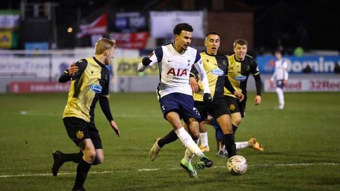 CROSBY, ENGLAND - JANUARY 10: Dele Alli of Tottenham Hotspur battles for possession with Josh Hmami of Marine during the FA Cup Third Round match between Marine and Tottenham Hotspur at Rossett Park on January 10, 2021 in Crosby, England. Sporting stadiums around England remain under strict restrictions due to the Coronavirus Pandemic as Government social distancing laws prohibit fans inside venues resulting in games being played behind closed doors. (Photo by Clive Brunskill/Getty Images)