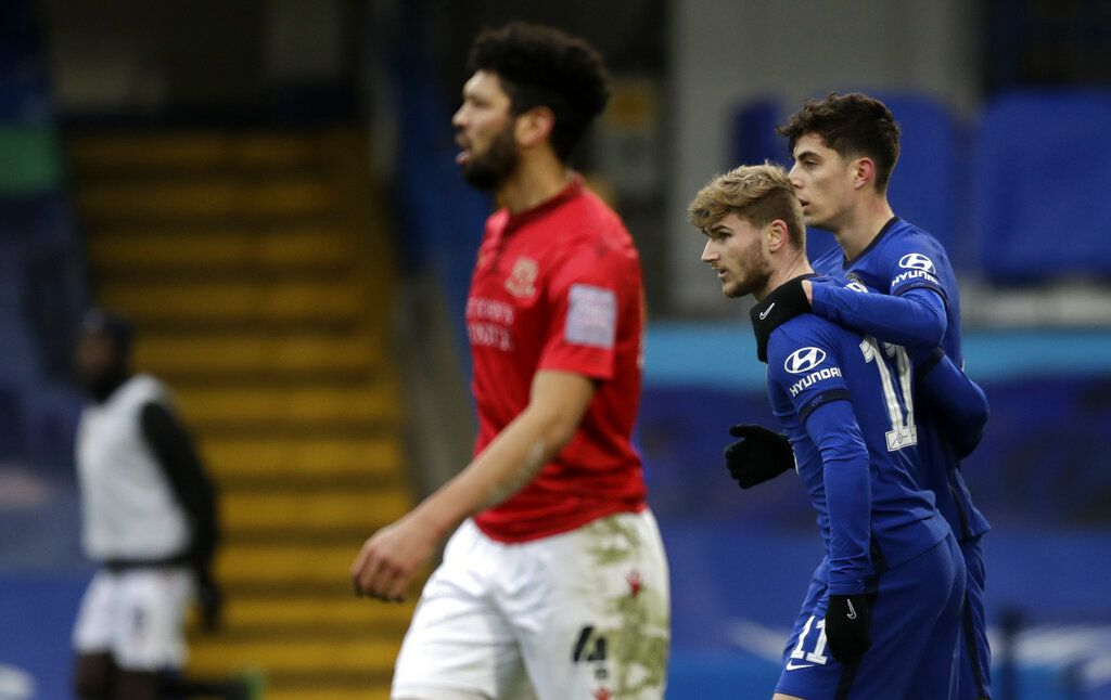 Chelsea's Timo Werner, second right, celebrates with Chelsea's Kai Havertz after scoring his side's second goal during the English FA Cup third round soccer match between Chelsea and Morecambe at Stamford Bridge Stadium in London, Sunday, Jan. 10, 2021. (AP Photo/Matt Dunham)