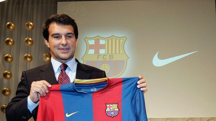FRANKFURT, GERMANY - JUNE 21:  FC Barcelona President Joan Laporta reveals home shirt for the 2006/07 season during a press conference on June 21, 2006 in Frankfurt, Germany. The Away kit is inspired by the orange kit worn by Barcelonas 1992 European Cup winning team. (Photo by Jan Pitman/Getty Images)