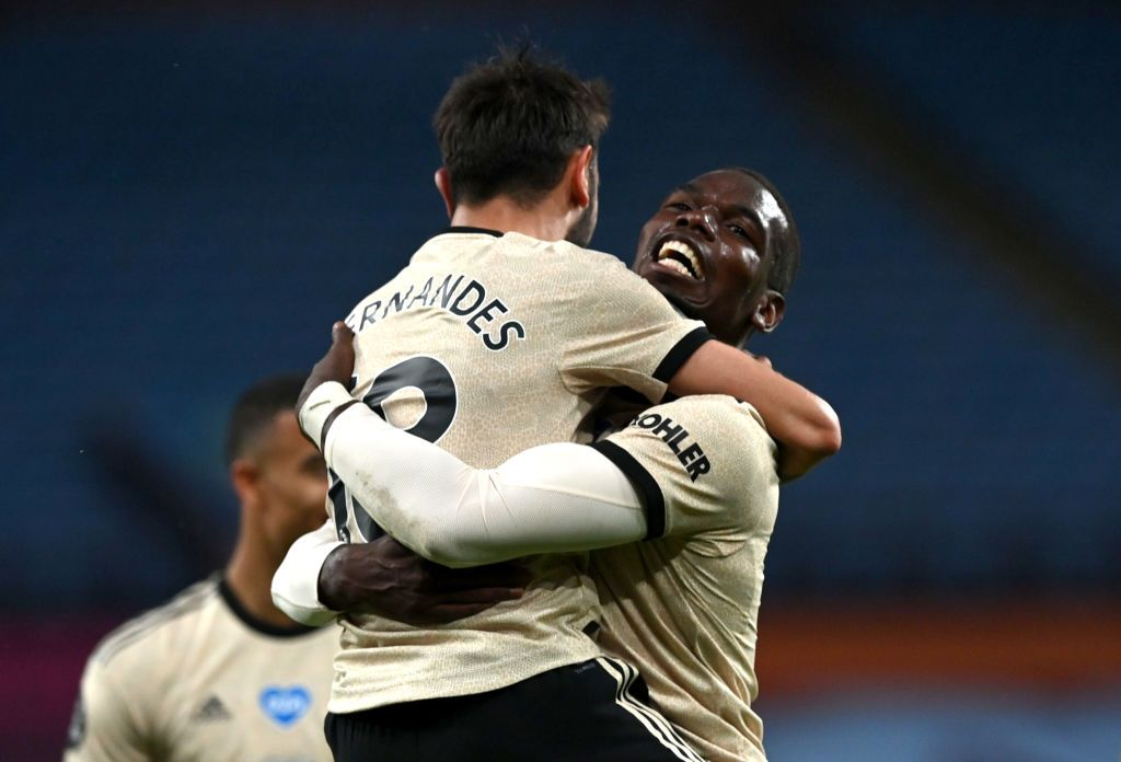BIRMINGHAM, ENGLAND - JULY 09: Paul Pogba of Manchester United celebrates with Bruno Fernandes after scoring his team's third goal during the Premier League match between Aston Villa and Manchester United at Villa Park on July 09, 2020 in Birmingham, England. Football Stadiums around Europe remain empty due to the Coronavirus Pandemic as Government social distancing laws prohibit fans inside venues resulting in all fixtures being played behind closed doors. (Photo by Shaun Botterill/Getty Images)