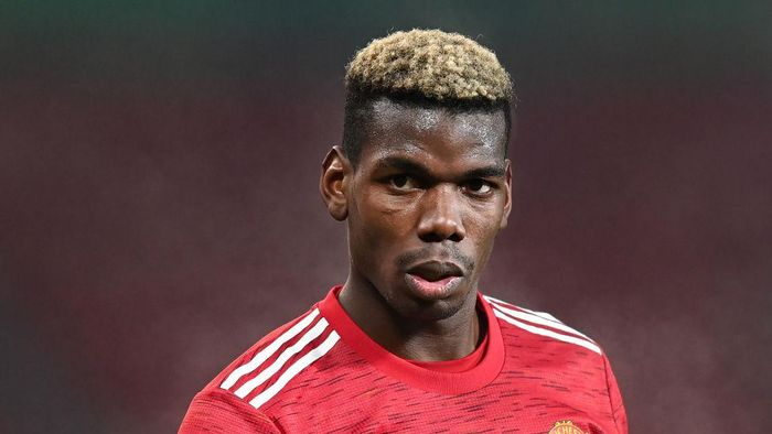 MANCHESTER, ENGLAND - DECEMBER 29: Paul Pogba of Manchester United in action during the Premier League match between Manchester United and Wolverhampton Wanderers at Old Trafford on December 29, 2020 in Manchester, England. The match will be played without fans, behind closed doors as a Covid-19 precaution. (Photo by Michael Regan/Getty Images)