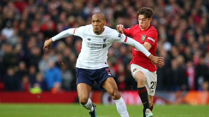 MANCHESTER, ENGLAND - OCTOBER 20: Fabinho of Liverpool looks to break past Daniel James of Manchester United during the Premier League match between Manchester United and Liverpool FC at Old Trafford on October 20, 2019 in Manchester, United Kingdom. (Photo by Alex Livesey/Getty Images)