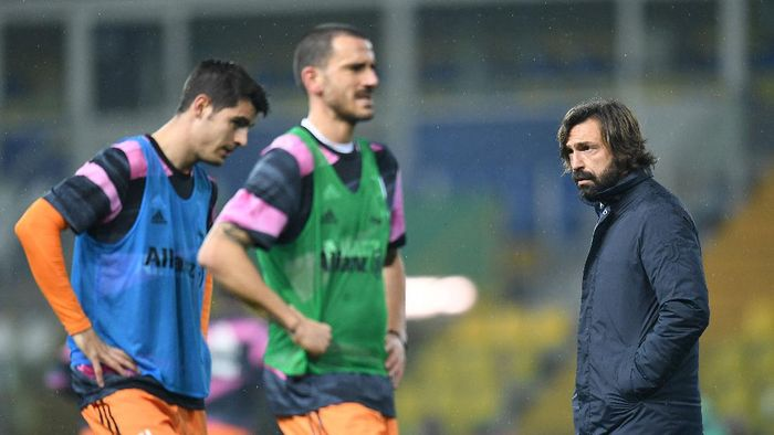PARMA, ITALY - DECEMBER 19: Andrea Pirlo head coach of Juventus looks on during the Serie A match between Parma Calcio and Juventus at Stadio Ennio Tardini on December 19, 2020 in Parma, Italy. Sporting stadiums around Italy  remain under strict restrictions due to the Coronavirus Pandemic as Government social distancing laws prohibit fans inside venues resulting in games being played behind closed doors. (Photo by Alessandro Sabattini/Getty Images)