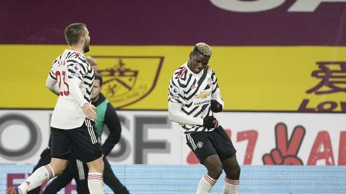 Manchester Uniteds Paul Pogba, right, dances as he celebrates after scoring during the English Premier League soccer match between Burnley and Manchester United in Burnley, England, Tuesday, Jan. 12, 2021. Manchester won the match 1-0.(AP Photo/Jon Super,Pool)