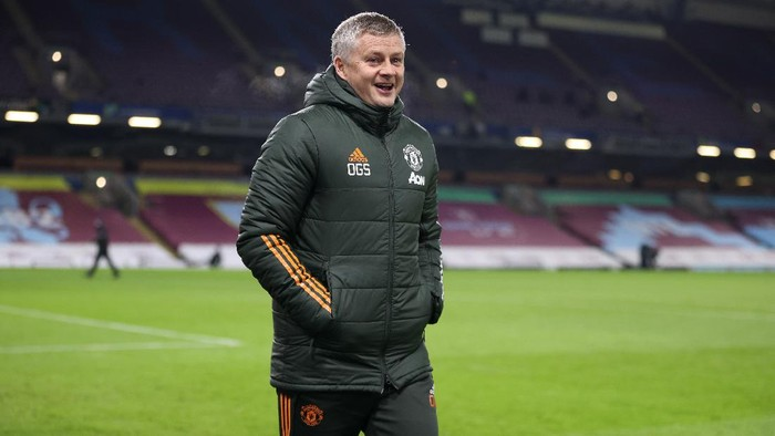 BURNLEY, ENGLAND - JANUARY 12: Ole Gunnar Solskjaer, Manager of Manchester United walks on to the pitch to his teams dug out prior to the Premier League match between Burnley and Manchester United at Turf Moor on January 12, 2021 in Burnley, England. Sporting stadiums around England remain under strict restrictions due to the Coronavirus Pandemic as Government social distancing laws prohibit fans inside venues resulting in games being played behind closed doors. (Photo by Clive Brunskill/Getty Images)