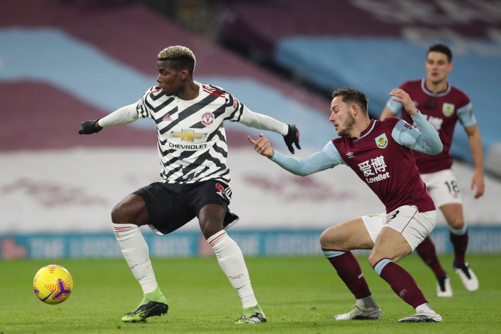 BURNLEY, ENGLAND - JANUARY 12: Paul Pogba of Manchester United is challenged by Josh Brownhill of Burnley during the Premier League match between Burnley and Manchester United at Turf Moor on January 12, 2021 in Burnley, England. Sporting stadiums around England remain under strict restrictions due to the Coronavirus Pandemic as Government social distancing laws prohibit fans inside venues resulting in games being played behind closed doors. (Photo by Clive Brunskill/Getty Images)