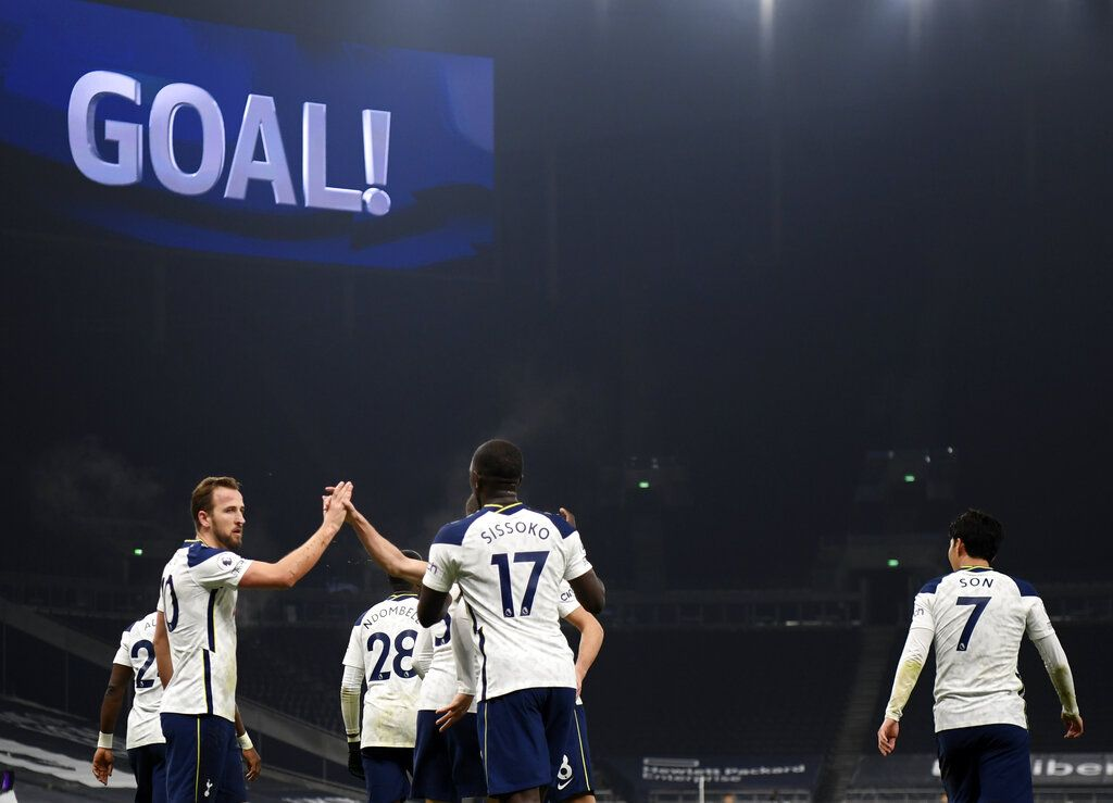 Tottenham's Harry Kane, left, celebrates with teammates after scoring his side's opening goal during the English Premier League soccer match between Tottenham Hotspur and Fulham at the Tottenham Hotspur Stadium in London, Wednesday, Jan. 13, 2021. (Shaun Botterill/Pool via AP)