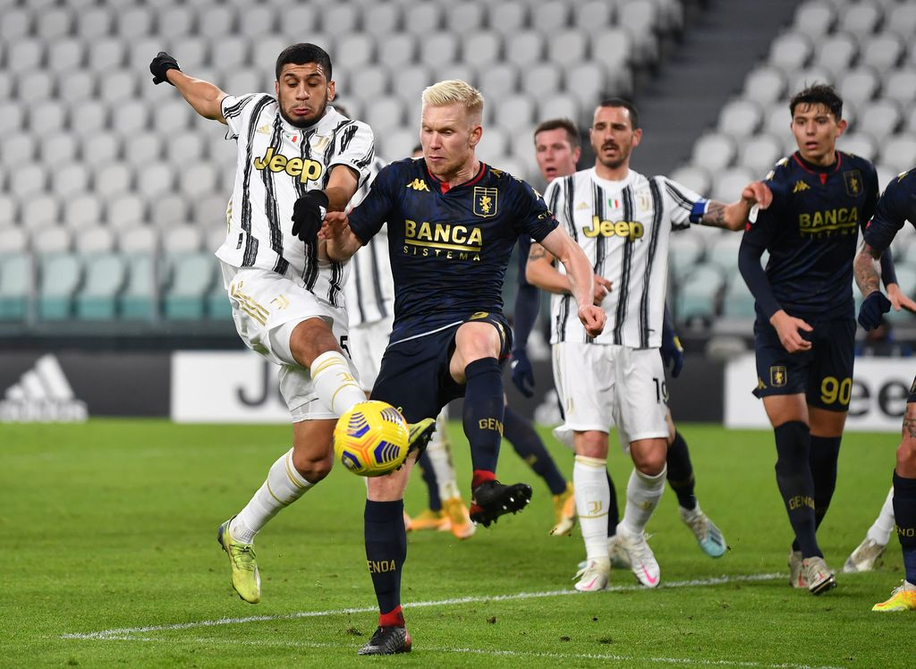 TURIN, ITALY - JANUARY 13: Hamza Rafia of Juventus F.C. and Lennart Czyborra of Genoa battle for possession during the Coppa Italia match between Juventus and Genoa CFC at Allianz Stadium on January 13, 2021 in Turin, Italy. Sporting stadiums around Italy remain under strict restrictions due to the Coronavirus Pandemic as Government social distancing laws prohibit fans inside venues resulting in games being played behind closed doors. (Photo by Valerio Pennicino/Getty Images)