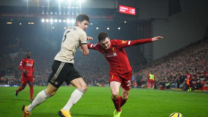 LIVERPOOL, ENGLAND - JANUARY 19: Harry Maguire of Manchester United and Andrew Robertson of Liverpool in action during the Premier League match between Liverpool FC and Manchester United at Anfield on January 19, 2020 in Liverpool, United Kingdom. (Photo by Michael Regan/Getty Images)