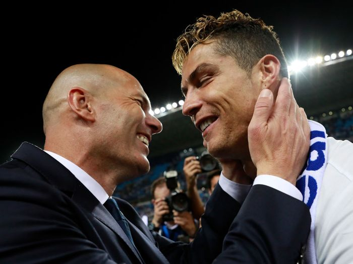 MALAGA, SPAIN - MAY 21:  Zinedine Zidane, Manager of Real Madrid celebrates with Cristiano Ronaldo after being crowned champions following the La Liga match between Malaga and Real Madrid at La Rosaleda Stadium on May 21, 2017 in Malaga, Spain.  (Photo by Gonzalo Arroyo Moreno/Getty Images)