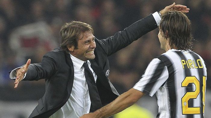 TURIN, ITALY - OCTOBER 02:  Juventus FC manager Antonio Conte celebrates the victory with Andrea Pirlo at the end of the Serie A match between Juventus FC and AC Milan on October 2, 2011 in Turin, Italy.  (Photo by Marco Luzzani/Getty Images)