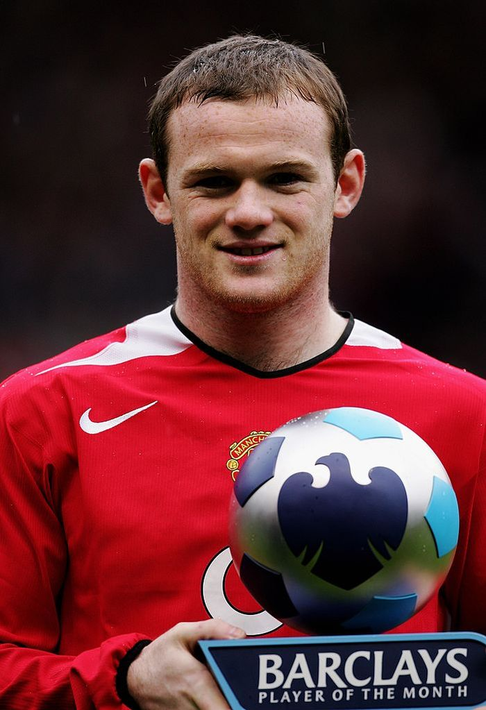 MANCHESTER, UNITED KINGDOM - APRIL 09:  Wayne Rooney of Manchester United poses with his Barclays Player of the Month Award prior to the Barclays Premiership match between Manchester United and Arsenal at Old Trafford on April 9, 2006 in Manchester, England.  (Photo by Alex Livesey/Getty Images)