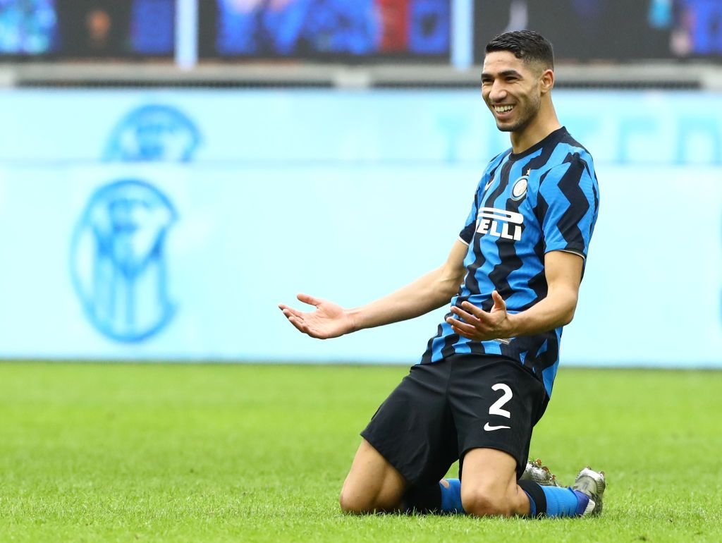 MILAN, ITALY - JANUARY 03: Achraf Hakimi of Inter Milan celebrates after scoring their sides sixth goal during the Serie A match between FC Internazionale and FC Crotone at Stadio Giuseppe Meazza on January 03, 2021 in Milan, Italy. Sporting stadiums around Italy remain under strict restrictions due to the Coronavirus Pandemic as Government social distancing laws prohibit fans inside venues resulting in games being played behind closed doors. (Photo by Marco Luzzani/Getty Images)