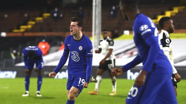 Chelsea's Mason Mount celebrates after scoring his side's opening goal during the English Premier League soccer match between Fulham and Chelsea at Craven Cottage in London, England, Saturday, Jan. 16, 2021. (Clive Rose/Pool via AP)