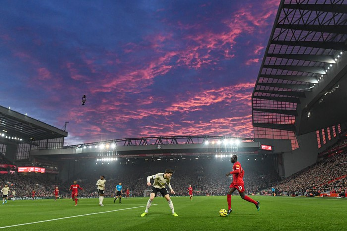 LIVERPOOL, ENGLAND - JANUARY 19: Saido Mane of Liverpool in action as the sun sets during the Premier League match between Liverpool FC and Manchester United at Anfield on January 19, 2020 in Liverpool, United Kingdom. (Photo by Michael Regan/Getty Images)