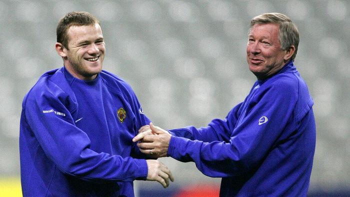FILE - In this Tuesday, Nov. 1, 2005 file photo Wayne Rooney of Manchester United, left, jokes with his coach Alex Ferguson during a training session at the Stade de France stadium, outside Paris. Lille will face Manchester United Wednesday in a European Champions League match. Wayne Rooney now has the Derby County job on a permanent basis after England's record goal-scorer retired from playing and received a contract through 2023 to manage the second tier team. The 35-year-old former Manchester United captain, who took temporary charge of Derby in November, is now focusing on his coaching career.  (AP Photo/Christophe Ena, File)