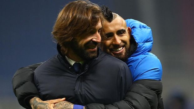 MILAN, ITALY - JANUARY 17: Andrea Pirlo, Head Coach of Juventus interacts with Arturo Vidal of Internazionale following the Serie A match between FC Internazionale and Juventus at Stadio Giuseppe Meazza on January 17, 2021 in Milan, Italy. Sporting stadiums around Italy remain under strict restrictions due to the Coronavirus Pandemic as Government social distancing laws prohibit fans inside venues resulting in games being played behind closed doors. (Photo by Marco Luzzani/Getty Images)