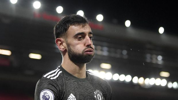 Manchester United's Bruno Fernandes reacts after having a shot blocked during the English Premier League soccer match between Liverpool and Manchester United at Anfield Stadium, Liverpool, England, Sunday, Jan. 17, 2021. (Michael Regan/Pool via AP)