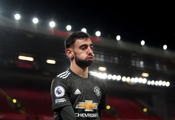 LIVERPOOL, ENGLAND - JANUARY 17: Bruno Fernandes of Manchester United reacts after a near miss during the Premier League match between Liverpool and Manchester United at Anfield on January 17, 2021 in Liverpool, England. Sporting stadiums around England remain under strict restrictions due to the Coronavirus Pandemic as Government social distancing laws prohibit fans inside venues resulting in games being played behind closed doors. (Photo by Michael Regan/Getty Images)