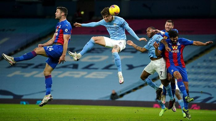 MANCHESTER, ENGLAND - JANUARY 17: John Stones of Manchester City scores their sides first goal during the Premier League match between Manchester City and Crystal Palace at Etihad Stadium on January 17, 2021 in Manchester, England. Sporting stadiums around England remain under strict restrictions due to the Coronavirus Pandemic as Government social distancing laws prohibit fans inside venues resulting in games being played behind closed doors. (Photo by Dave Thompson - Pool/Getty Images)