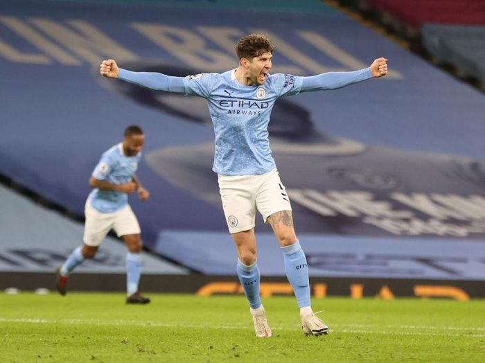MANCHESTER, ENGLAND - JANUARY 17: John Stones of Manchester City  celebrates after scoring their sides third goal during the Premier League match between Manchester City and Crystal Palace at Etihad Stadium on January 17, 2021 in Manchester, England. Sporting stadiums around England remain under strict restrictions due to the Coronavirus Pandemic as Government social distancing laws prohibit fans inside venues resulting in games being played behind closed doors. (Photo by Clive Brunskill/Getty Images)