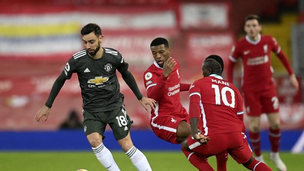 Manchester United's Bruno Fernandes controls the ball during the English Premier League soccer match between Liverpool and Manchester United at Anfield Stadium, Liverpool, England, Sunday, Jan. 17, 2021. (Michael Regan/Pool via AP)